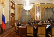 Russian Prime Minister Dmitry Medvedev (left) at the Cabinet meeting