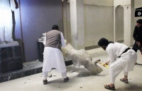 Islamic state militants with sledgehammers destroying ancient artifacts in the Ninevah Museum in Mosul, Iraq